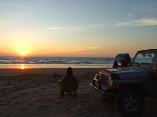 Dan & Jeep enjoying a sunset over the Pacific Ocean