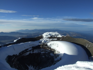 Volcano Cotopaxi crater (tiny amount of smoke on left)
