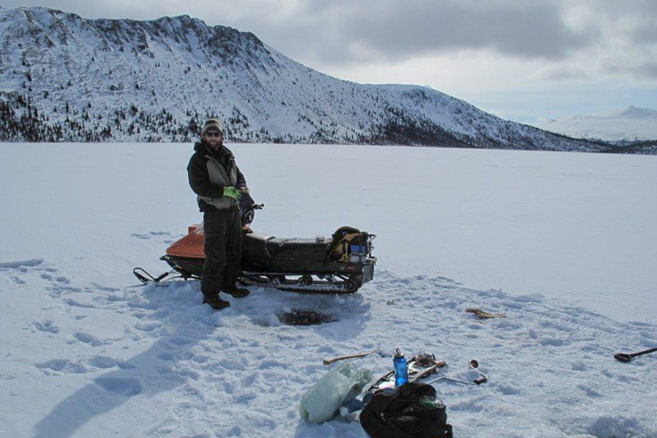 Ice Fishing from the comfort of the snowmobile seat