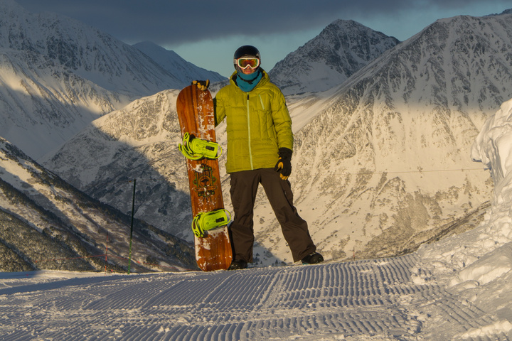 Dan and snowboard on the summit of Alyeska Resort. The mountains are absolutely enormous.