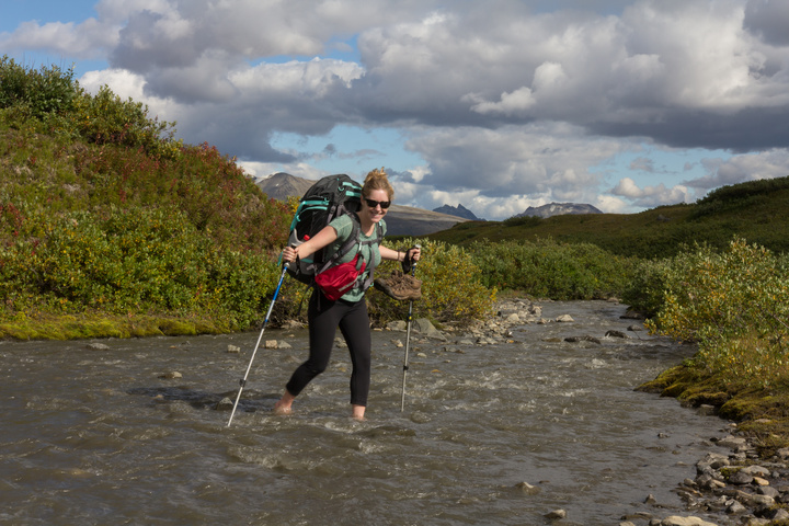 Heather crossing a small river
