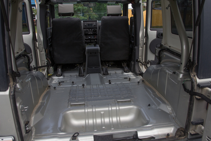 After removing the backseat, carpet and trim