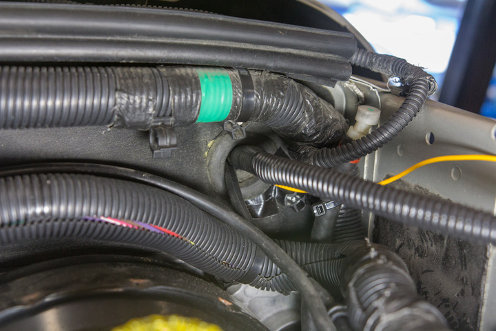 Factory grommet for rear wiper fluid - very top corner of firewall on drivers side
