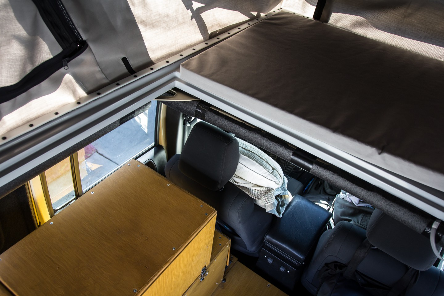 View while standing up looking down through opening towards drivers seat & Ursa Minor J30 Pop Up Camper | The Road Chose Me