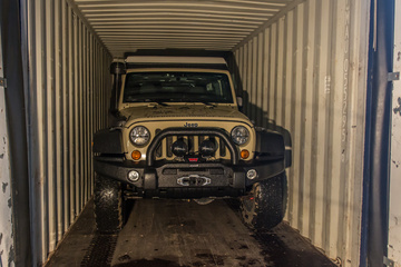 The Jeep snug in the container