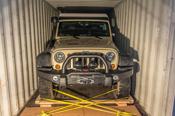 The Jeep lashed securely to the container