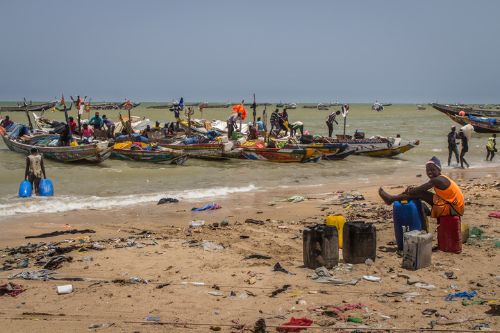 mbour fish market boats and trash 720x480