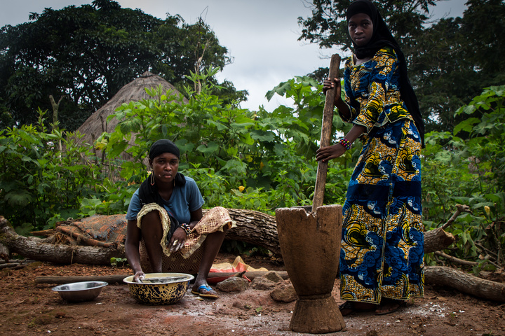 Ladies working hard to grind flour by hand