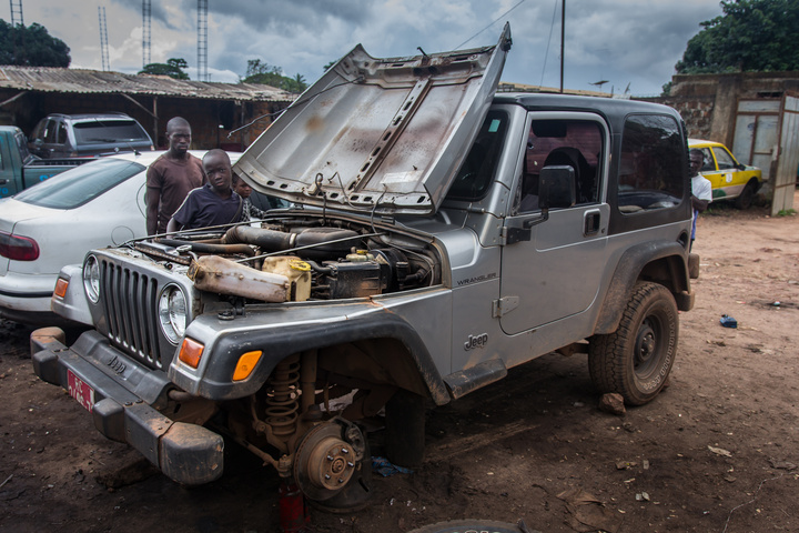 I saw some guys working on this Jeep TJ - and was shocked to find it identical to the one I drove to Argentina. Same year, same engine. No idea what they were doing to it.