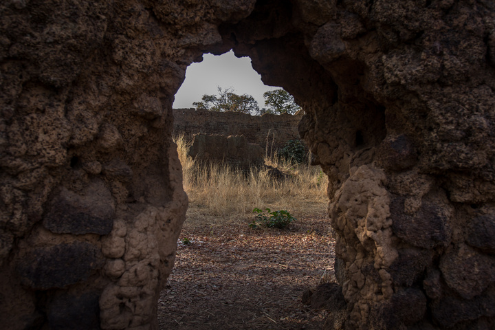 A crumbling arch looking through Loropeni