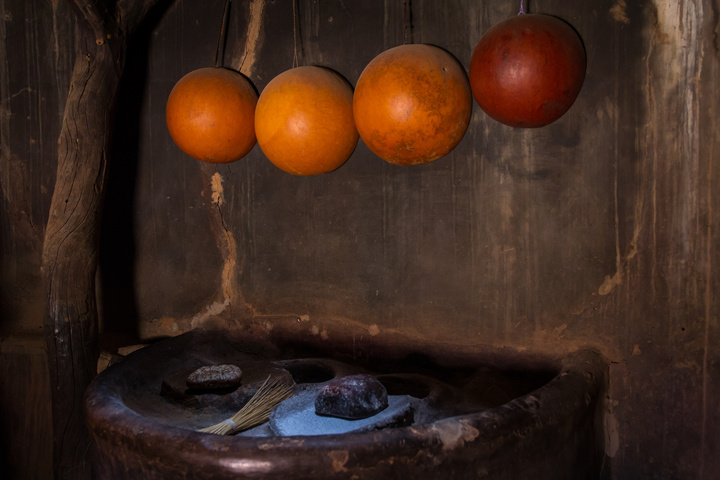 Inside a hut, the place to grind flour by hand