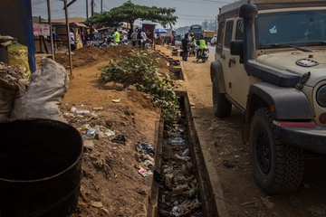 A typical town in Cameroon, trash on every single surface, open sewer