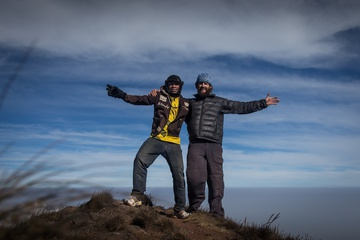 Dan and Augustine on the summit, loving life