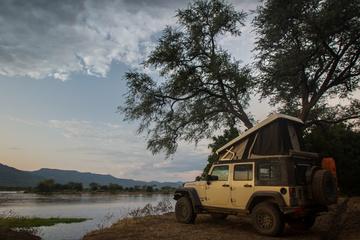 Right on the bank of the Zambezi (croc directly below Jeep)