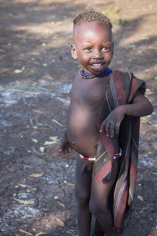 mursi smiling kid 320x480