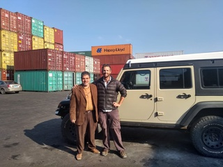 With Ayman moments before driving into the container